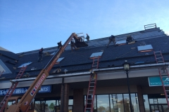 Installation of shingle roof in Barrington RI shopping plaza with new custom skylights